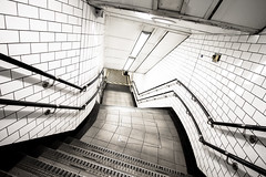 Harsh Light - Explored (Sean Batten) Tags: city uk england white london lines stairs subway nikon metro tube steps tiles londonunderground nottinghillgate d800 1424