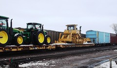 Ames, Iowa, Union Pacific Railroad, John Deere Tractors, Caterpillar Bulldozer, Flat Cars, Ames Yard (photolibrarian) Tags: amesiowa unionpacificrailroad johndeeretractors flatcars caterpillarbulldozer amesyard