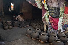 Potter (Creative Shah) Tags: street red people india streets indian potter pot hardwork