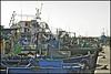 fishing boats of kelibia .... (ana_lee_smith) Tags: travel blue sea green tourism water vintage lens boats photography coast town fishing dock mediterranean harbour tunisia rope quay beercan fishingboats tones northeast knots kelibia peninsular capbon analeesmith minoltaaf70210mm sonyslta33