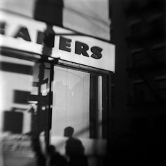 Corner (robert schneider (rolopix)) Tags: street nyc newyorkcity blackandwhite bw ny newyork blur 6x6 film monochrome corner mediumformat square store blurry closed shadows kodak tx trix toycamera 400 brownie hawkeye expired plasticcamera outdated bhf browniehawkeyeflash flippedlens outofdate 120620 robertschneider autaut bwfp believeinfilm rolopix
