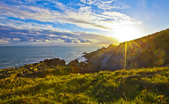 Sun Chaser (Jonathan J Scott) Tags: ocean blue sunset sea sun seascape beauty grass yellow clouds landscape rocks colours ethereal flare rays colourful sunrays striking 5dmk2