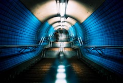 double vision (fotobes) Tags: blue man london stairs underground person lca xpro crossprocessed doubleexposure crossprocess steps tunnel multipleexposure tiles staircase londonunderground lookingdown embankment handrails embankmentstation kodakelitechrome100 thatembankmentstaircase