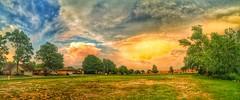 Weather entertainment (Pejasar) Tags: clouds weather sunset storm remainsoftheday rain pano panoramic grass tress tulsa oklahoma