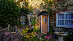 Tradition (TanzPanorama ( catching up )) Tags: cottage dwelling garden door light tanzpanorama sonya7ii ilce7m2 sony fe1635mmf4zaoss sel1635z variotessartfe1635mmf4zaoss flowers flowerscolours secluded england bosham travel flickr house stone english europe quaint old traditional tradition