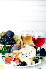 Wine, grape and cheese over white (lyule4ik) Tags: wine food grape cheese drink fig appetizer red meal yellow walnut cutting parmesan board glass text deli italian brick soft berry romano sample chunk leaf copyspace maroon cork muenster hard bottle butcher ricotta wedge white french delicatessen chopping munster block crackers isolated slice snack alcohol dairy camembert closeup plate dessert