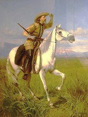 Buffalo Bill dressed as a scout on his horse Isham.  Painting by Pappacena (1872). (lhboudreau) Tags: buffalobill buffalobillmuseum museum lookoutmountain colorado usa williamfcody williamfbuffalobillcody cody buffalobillcody scout buckskins horse rifle whitehorse isham painting pappacena 1872 cowboyhat field exhibit armyscout boots saddle leather horseback