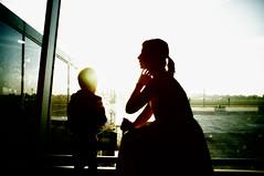 """sunrise at the gate"" or ""mother and son"" (kirilko) Tags: motherandson silhouette sunrise fujix100 fujifinepix 35mm contrejour highcontrast kbp kyiv ukraine boryspil atgate airport morning"