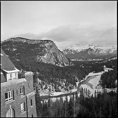 Banff Springs (JimShootsFilm) Tags: winter mountain snow canada mountains film mediumformat square rockies hotel hasselblad alberta squareformat banff rockymountains ilford fp4 banffnationalpark banffspringshotel banffsprings ilfordfp4 hasselblad500cm banffpark hasselblad500