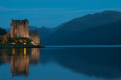 Eilean Donan Castle (explored #97 1st Feb) (Photeelover) Tags: lighting bridge blue sunset cloud mountain lake mountains colour reflection building skye castle nature water night clouds contrast landscape evening scotland highlands interesting colours unitedkingdom dusk scenic loch eileen eilean donan eileandonan lochs eileendonan explored eileancastle