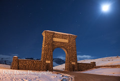 The North Gate of Yellowstone NP (Deby Dixon) Tags: nightphotography winter moon snow nature night stars landscape nationalpark montana entrance moonlit yellowstonenationalpark moonlight northgate debydixonphotography