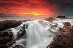 Reign of Fire (Explored) (Fakrul J) Tags: ocean sky cloud seascape beach water colors sunrise rocks waves skies shore foam malaysia burningsky canondslr terengganu eastcoast wirelessremote dungun llens rockyshoreline reignoffire canoncameras leefilters canonef1740mm tanjungjara canoneflenses canoneos5dmarkii phottix slowshutterphotography 5dmarkii reversegrad fakruljamil wwwfakruljamilcom proglassnd phottixaion 3stopproglassnd singhray3stopsreversegraduatedfilter