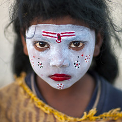 Little girl with make up in Kumbh Mela, Allahabad, India (Eric Lafforgue) Tags: portrait india girl face make up festival closeup square outdoors photography kid eyes women asia day child goddess n indie mass shiva hindu indi hinduism pilgrimage pilgrim oneperson inde onepeople frontview hodu mela sangam allahabad headandshoulders haridwar indland  uttarpradesh  kumbhmela colorimage 2875 onewomanonly indianculture lookingatcamera kumbh 45years    mahakumbhamela  indianethnicity   hndkastan