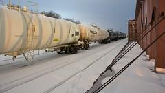 (orangedot777) Tags: railroad winter snow cold minnesota night train traintracks tracks 169 railyard nocturne northfield freighttrain tankercar