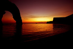 ... (Agi - Agnieszka Lewkowicz) Tags: sunset red sea england sky silhouette night landscape photography seaside scenery view agi durdledoor zachod niebo slonca nikond40x agnieszkalewkowicz