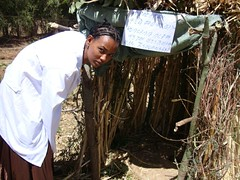 Health Extension Worker from Gondar Zuria Woreda, Maksegnit town. Amhara, showing how to build model latrine with handwashing.
