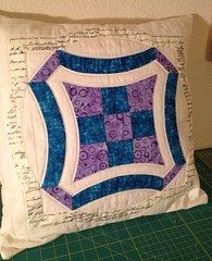 Urban Deco Pillow (ZyborCraftinator) Tags: blue purple quilt natural text pillow quilting quilted quilts curve curved muslin pieced 9patch