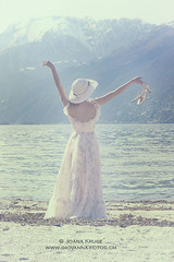 woman on beach (Ticino-Joana) Tags: sea summer woman sun lake beach nature water floral girl beautiful hat female vintage relax outside outdoors person shoe back shoes dress dream young sunny dreaming shore frombehind barefoot romantic barefeet elegant relaxed anonymous enjoying elegance caucasian sunhat shoeless summery unshod