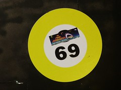 69 (Rusty Clark) Tags: yellow shop circle mirror sticker smoke ring number