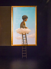 The Cloud Sitter (Steve Taylor (Photography)) Tags: art artwork graffiti mural painting picture streetart wall blue brown mauve purple up fun boy lad kid newzealand nz southisland canterbury christchurch city shadow cloud sky spectrum ymca festival ladder vest frame sitting dreamy