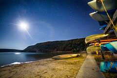 Canoes in the Moonlight (PhotoJacko - Jackie Novak) Tags: devilslake2016 moon night beach canoes devilslakestatepark baraboo wisconsin campground landscape outdoors moonlight rokinon14mmf28 canon 6d
