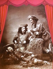 """Publicity photo for the play """"Scouts of the Prairie"""" starring (left to right) Buffalo Bill, Ned Buntline and Texas Jack Omohundro (1873). (lhboudreau) Tags: buffalobill buffalobillmuseum museum lookoutmountain colorado usa williamfcody williamfbuffalobillcody cody buffalobillcody buckskins cowboyhat hats cowboyhats exhibit armyscout beards mustaches longhair buckskinscoutoutfits scouts indianscouts publicityphoto entertainment stageplay scoutsoftheprairie nedbuntline jackomohundro omohundro texasjackomohundro scout indianscout buckskinoutfits monochrome blackandwhite texasjack"""