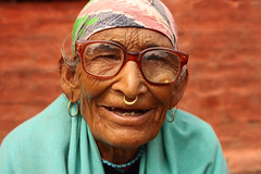 3498 The old lady on Durbar Square - Kathmandu, Nepal 2009 (cococinema) Tags: street old trip travel blue nepal red portrait orange woman brick smile smiling stone wall lady scarf way square asian photography gold glasses golden photo beads asia hole outdoor turquoise colorfull documentary ears best adventure kathmandu earrings durbar 2009 nepali theholeintheear
