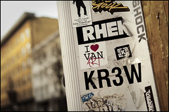 Gastown street art (Eric Flexyourhead) Tags: city urban canada detail art vancouver graffiti promo bc bokeh britishcolumbia tag stickers ad pole advertisement gastown powellstreet fragment kr3w rhek panaleica25mmf14 leicadgsummilux25mmf14asph olympusem5