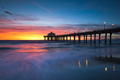 watercolors (Andy Kennelly) Tags: ocean california grandma sunset motion color beach night reflections watercolor lights pier long exposure pacific cloudy manhattan explosion sugar goodbye