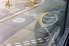 23 December, 11.30 (Ti.mo) Tags: uk travel england travelling london tarmac iso100 airport slow heathrow pavement marking ashphalt 52mm 0ev  secatf40 e35mmf18oss