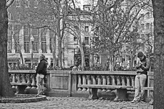 the distance between us (lucymagoo_images) Tags: park city trees urban bw men philadelphia monochrome mobile square concrete sony rittenhouse device cobblestones disconnected remote philly benches distance apart separated disconnect rx100 lucymagoo lucymagooimages