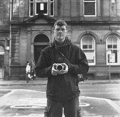My camera and me in Perth (Zeb Andrews) Tags: city uk urban blackandwhite bw selfportrait streets film analog square mirror scotland europe hasselblad perth kodaktrix oldworld hasselblad500c bluemooncamera mycameraandi todaysthemewillbescottishreflectionsofpeople butthisisthelastimagefromperth