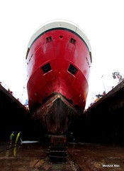Day 228 big ship in drydock (mootzie) Tags: red ship huge drydock hardhats seawater draining repainted aberdeenscotland
