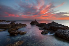 Red rising sky (Luca Zappacosta) Tags: red sky italy water dawn twilight rocks italia alba stones reserve p