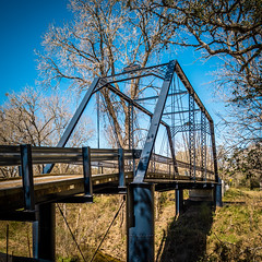 Piano Bridge III (Mabry Campbell) Tags: old bridge trees sky usa photography march countryside us photo texas photographer unitedstates image tx unitedstatesofamerica country bluesky historic photograph 100 24mm february f71 fayettecounty tiltshift 2013 pianobridge tse24mmf35l sec eos5dmarkiii mabrycampbell march32013 201303030h6a0803