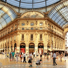 Galleria Vittorio Emanuele II in Milan (Bn) Tags: street city blue summer sky italy sun holiday money milan hot window weather shop mall shopping walking square cuisine louis warm italia catholic cathedral roman top milano pigeons centre sightseeing restaurants sunny tourist gucci milaan ii covered shops summertime marble piazza duomo charming exquisite middle too prada ages galleria romans attractions emanuele vittorio luxurious duomodimilano louisvutton vutton 35c 1386 atmospheres dommdemilan