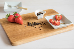 211/366: Strawberry surprise (judi may) Tags: 366the2016edition 3662016 day211366 29jul16 strawberries blackpepper blackpeppercorns balsamicvinegar balsamic wood white dish dishes woodenboard table tabletopphotography food foodstyling stilllife fork canon7d dof