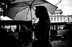 Umbrella Silhouette (stimpsonjake) Tags: nikoncoolpixa 185mm streetphotography bucharest romania city candid blackandwhite bw monochrome silhouette umbrella woman highcontrast