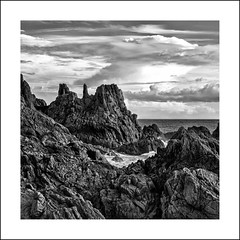 Rocks somewhere near Corbiere (Explored) (Jacobjacobi) Tags: landscape blackwhite waves sigma jersey squarecrop manfrotto corbiere explored sigma1770 lightroom4 silverefexpro2