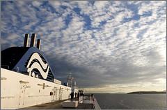 ferry clouds (tesseract33) Tags: world ocean travel blue light sea sky people clouds boats boat ships digitalart bluesky victoria nikondigital ferries bcferries cloudysky georgiastraight nikond300 peterlangphotography blinkagain peterlangphotographynet