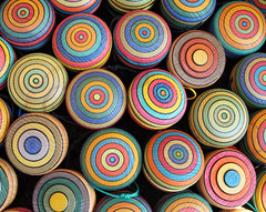 Yoyo brightly colored (Batikart) Tags: blue red summer orange black game green colors lines yellow closeup canon germany circle geotagged toy outdoors deutschland mix focus europa europe colours dof play bright market vibrant sommer stripes patterns ring collection round colored leisure ribbon choice practice multicolored markt ursula onsale coloured jojo yoyo assortment variation mixture