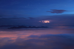 Lightning on a Sea of Clouds (a galaxy far, far away...) Tags: nightphotography mountain alps nature night clouds montagne alpes canon landscape noche nuvole mood nacht outdoor hiking dream wolke atmosphere nat natura dreamy bluehour lightning wilderness alpen nuage alpi nuit montagna notte atmospheric nube mystic noc valsusa wolk massif otherworldly alpinism moln  onirico  rocciamelone oneiric orablu valdisusa alpigraie highmountain abigfave alpicozie graianalps valledisusa impressedbeauty flickrdiamond 1740canon rochemelon cottianalps 5dmarkii altavalsusa robertobertero