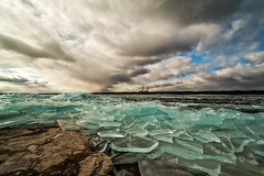 The Power Of Nature (Matt Molloy) Tags: blue winter seagulls canada ice broken nature water birds clouds landscape photography frozen flying amazing pieces awesome windy sheets limestone neat powerplant lakeontario powerful piles lovelife amherstisland betterlucknexttime foolishme mattmolloy mybabyisbroken windkilledmycamera whenmothernatureattacks atleastigotagoodshot