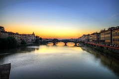 Sunset on the Arno River in Florence, Italy (` Toshio ') Tags: bridge blue light sunset sky italy sunlight reflection water yellow architecture buildings river florence europe italia european firenze arno europeanunion arnoriver toshio