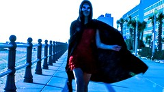 Devil in a Red Dress (Turbo666) Tags: fiction red motion beach beautiful canon movement gun dress legs adobe actress murder boardwalk hood cloak cinematic jvc suspense diamondclassphotographer flickrdiamond