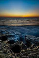 Where the Water Goes (John Cothron) Tags: ocean sky beach nature water rock seashells sunrise 35mm canon landscape dawn morninglight spring twilight sand florida outdoor scenic wave atlanticocean saltwater ze calcite sunshinestate coquina palmcoast flaglercounty washingtonoaksgardensstatepark guanatolomatomatanzasnationalestuarineresearchreserve johncothron 5dmkii distagont2821 cothronphotography zeissdistagont21mm28ze 2jtrip20121 johncothron img09075120406