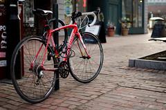Locked Red Allez (David Van Chu) Tags: portland maine downtown nikon d7000 nikond7000 35mmf18g afs35mmf18g locked red allez specialized road bike sidewalk 2013 david van chu davidvanchu davidchu