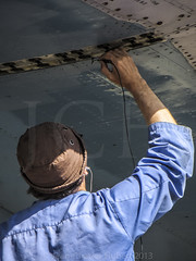 Close inspection (LASCAR35) Tags: aviation scrapyard mechanic opf antonov opalocka an12b srxtranscontinental uk120005