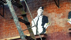hitch' with the golden gun (eFB) Tags: streetart newyork bricks alfred hitchcock alfredhitchcock