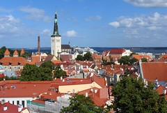 The roofs of old town Tallinn, Estonia (KaarinaT) Tags: tallinn estonia roofs redroofs sky clouds oldtown hanseaticleaguetown architecture old historic spire church finesummerday touristspot balticstop